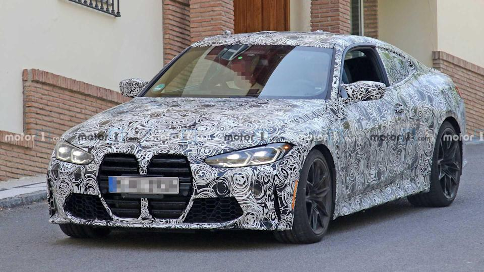 """<p>Here's yet another great at the new BMW M4's development. Is the nose growing on you yet?</p> <h3><a href=""""https://www.motor1.com/news/434419/2021-bmw-m4-coupe-spy/"""" rel=""""nofollow noopener"""" target=""""_blank"""" data-ylk=""""slk:2021 BMW M4 Coupe Spotted Showing You Know What"""" class=""""link rapid-noclick-resp"""">2021 BMW M4 Coupe Spotted Showing You Know What</a></h3> <br><a href=""""https://www.motor1.com/news/433400/2021-bmw-m4-spied-nurburgring/"""" rel=""""nofollow noopener"""" target=""""_blank"""" data-ylk=""""slk:2021 BMW M4 Spied Powersliding At The Nurburgring"""" class=""""link rapid-noclick-resp"""">2021 BMW M4 Spied Powersliding At The Nurburgring</a><br><a href=""""https://www.motor1.com/news/432570/2021-bmw-m4-spied-grille/"""" rel=""""nofollow noopener"""" target=""""_blank"""" data-ylk=""""slk:2021 BMW M4 Spied Showing Its Grille In Plain Sight"""" class=""""link rapid-noclick-resp"""">2021 BMW M4 Spied Showing Its Grille In Plain Sight</a><br>"""
