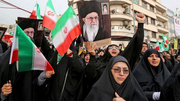 PHOTO: Iranian women holding national flags and pictures of the Islamic republic's supreme leader, Ayatollah Ali Khamenei, take part a pro-government demonstration in Tehran, Iran, Nov. 25, 2019. (Atta Kenare/AFP via Getty Images, FILE)