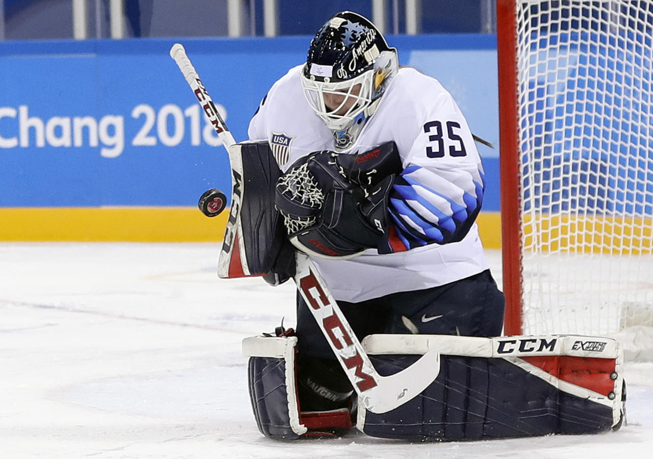 """CORRECTS MONTH OF SHOW TO MARCH, NOT FEB. - FILE - In this Feb. 11, 2018, file photo, United States' goalie Maddie Rooney blocks a shot during the first period of the preliminary round of the women's hockey game against Finland at the 2018 Winter Olympics in Gangneung, South Korea. Rooney and the U.S. women's gold-medal hockey team appeared on """"The Tonight Show Starring Jimmy Fallon,"""" on Monday, March. 5, 2018, where she said she'd like a chance to stop a shot from Justin Bieber, the hockey-playing Canadian pop star. (AP Photo/Frank Franklin II, File)"""