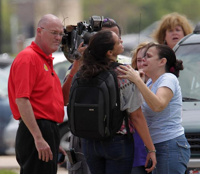 Lone Star College student Michelle Alvarez, second from right, is examined by her aunt Elena Tokarew, right, after the stabbings at Lone Star College's Cypress-Fairbanks campus Tuesday April 9, 2013, in Cyprus, Texas. Alvarez was one of the injured in the stabbing attack at the campus. (AP Photo/Houston Chronicle, James Nielsen)