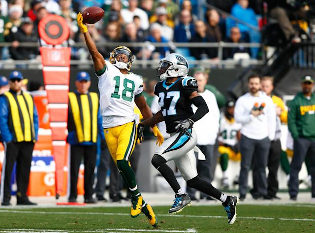 <p>Green Bay Packers wide receiver Randall Cobb (18) attempts catch a pass in the second quarter against Carolina Panthers cornerback Kevon Seymour (27) in the second quarter at Bank of America Stadium. Mandatory Credit: Jeremy Brevard-USA TODAY Sports </p>