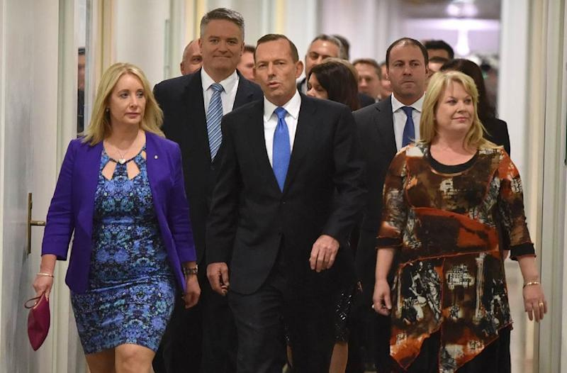 Australian Prime Minister Tony Abbott (C) walks though Parliament House in Canberra after he was dramatically ousted in a snap party vote forced by challenger Malcolm Turnbull on September 14, 2015 (AFP Photo/AFP)