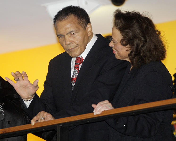 FILE - In this Jan. 14, 2012 file photo, boxing great Muhammad Ali, with his wife, Lonnie, right, waves to friends attending a celebration for his 70th birthday at the Muhammad Ali Center in Louisville, Ky. Ali wants to recognize some of the greatest humanitarians around the world. The first-ever Muhammad Ali Humanitarian Awards will be presented Oct. 3 in Louisville, Ky. _ the former heavyweight champion's hometown. The Muhammad Ali Center said Tuesday, Aug. 27, 2013, that six awards will honor people ages 35 and under for making significant contributions for peace, social justice and other humanitarian causes. (AP Photo/Mark Humphrey, File)