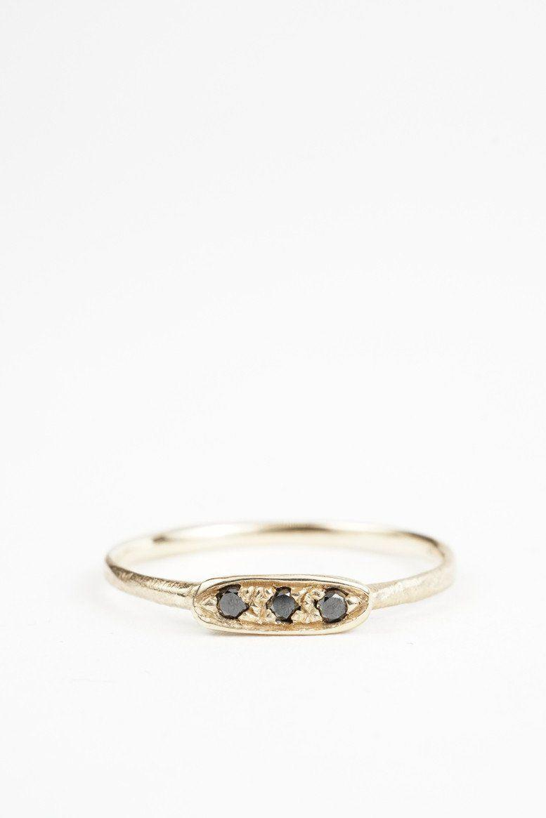 """<p><strong>Crown Nine</strong> Three Stone Black Diamond Ring, $700, available at <a href=""""https://www.crown-nine.com/collections/engagement-1"""" rel=""""nofollow noopener"""" target=""""_blank"""" data-ylk=""""slk:Crown Nine"""" class=""""link rapid-noclick-resp"""">Crown Nine</a>.</p>"""