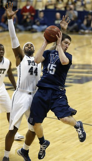 Villanova's Ryan Arcidiacono (15) looks to pass as Pittsburgh's J.J. Moore (44) defends in the second half of an NCAA college basketball game on Sunday, March 3, 2013, in Pittsburgh. (AP Photo/Keith Srakocic)