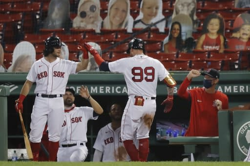 Boston Red Sox's Alex Verdugo (99) celebrates his solo home run during the eighth inning of a baseball game against the Toronto Blue Jays, Friday, Aug. 7, 2020, in Boston. (AP Photo/Michael Dwyer)