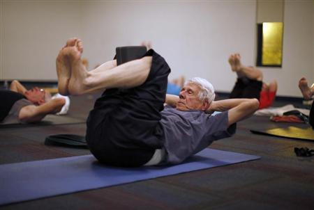 Retirees participate in a yoga class in Sun City