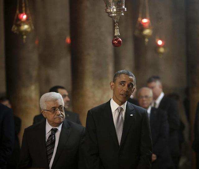 President Barack Obama and Palestinian President Mahmoud Abbas walk in the Church of the Nativity during their visit to the West Bank city of Bethlehem, Friday, March 22, 2013. (AP Photo/Pablo Martinez Monsivais)