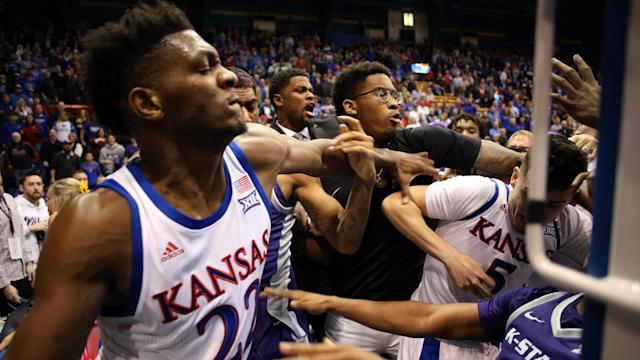 Silvio De Sousa will serve a 12-game ban for his role in the brawl between Kansas and Kansas State, the Big 12 Conference announced.