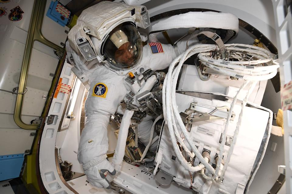 Today, NASA astronauts Victor Glover and Mike Hopkins are stepping outside the International Space Station for Glover's first spacewalk, or extravehicular activity (EVA). In this photo, you can see Glover preparing for the spacewalk, which will be his first. During the EVA, the pair will install a new antenna on the Columbus module on the outside of the space station.