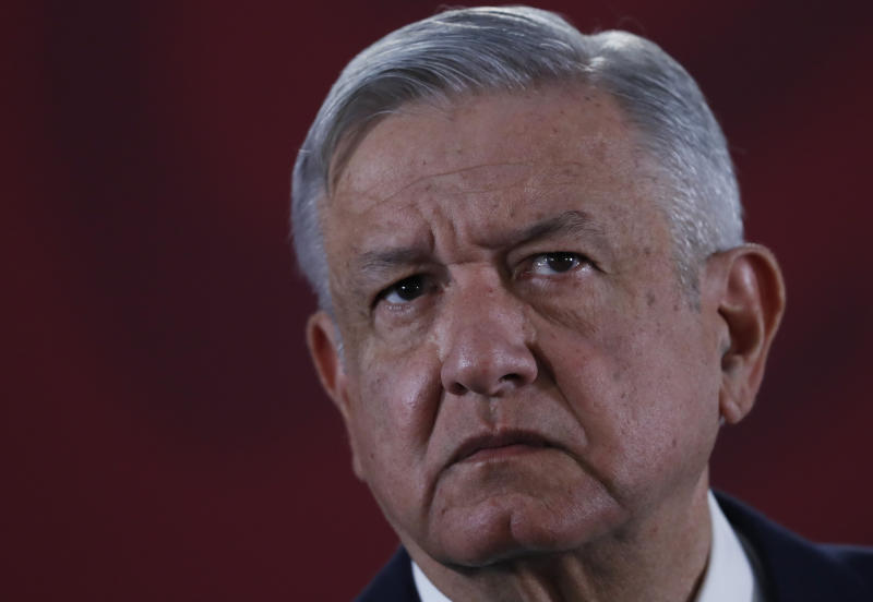 """FILE - In this Nov. 29, 2019 file photo, Mexican President Andres Manuel Lopez Obrador listens to questions during his daily morning press conference at the National Palace in Mexico City. Shortly before taking office Lopez Obrador decided to create an army of volunteers dubbed the """"servants of the nation,"""" to canvass people who receive government benefits collecting their personal information in part to see if they might be eligible for yet more help from various programs promised during the campaign for the likes of farmers, the disabled, unemployed youth and the elderly. The effort alarmed opposition political parties who saw it as an attempt to illegally use public funds to promote López Obrador and his leftist Morena party.  (AP Photo/Marco Ugarte, File)"""