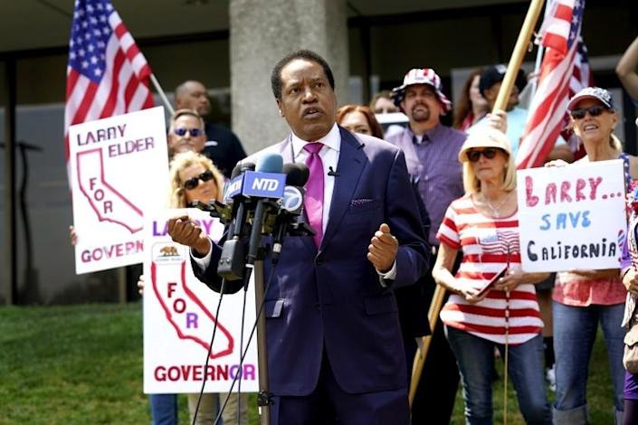 FILE — In this July 13, 2021 file photo radio talk show host Larry Elder speaks to supporters during a campaign stop in Norwalk, Calif. Californians will start receiving ballots next month asking if Gov. Gavin Newsom, a Democrat should be recalled and if so, who they want to vote to replace him. Elder is one of several high-profile Republicans, who are running to replace Newsom. The CAGOP's executive committee will meet Saturday July 24, 2021 and decide whether to let an endorsement move forward. (AP Photo/Marcio Jose Sanchez, File)