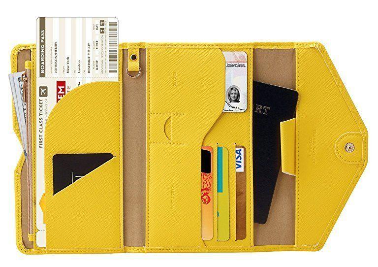"""If you know a """"Type-A"""" traveler, they'll appreciate how meticulously organized this travel wallet is, with room for a passport, cards, boarding passes, cash, coins and even a phone. <strong><a href=""""https://www.amazon.com/gp/product/B07K2PX4WC/"""" target=""""_blank"""" rel=""""noopener noreferrer"""">Get it here</a></strong>."""