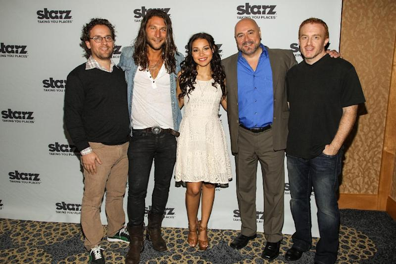 """From left, co-creator Robert Levine, actors Zach McGowan, Jessica Parket Kennedy, Mark Ryan, and co-creator Jon Steinberg attend the """"Black Sails"""" press line on Day 3 of 2013 Comic-Con International Convention on Friday, July 19, 2103, in San Diego. (Photo by Paul A. Hebert/Invision/AP)"""