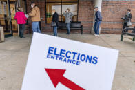 """In this Oct. 29, 2020, photo, voters line up as the doors open to the Election Center for absentee early voting for the general election in Sterling Heights, Mich. President-elect Joe Biden shored up the Democrats' """"blue wall,"""" — more sturdily in Michigan, more tenuously in Pennsylvania and Wisconsin — to rebuild the party's path back to the White House. (AP Photo/David Goldman)"""