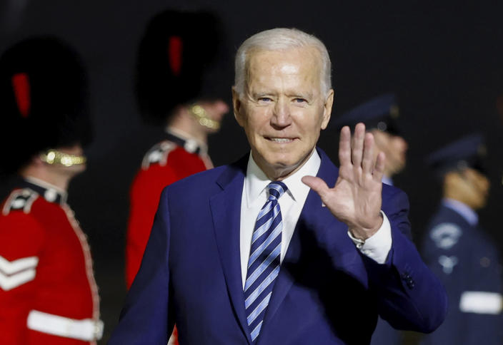 U.S. President Joe Biden waves on his arrival on Air Force One at Cornwall Airport Newquay, in Newquay, England, ahead of the G7 summit, Wednesday, June 9, 2021. (Phil Noble/Pool Photo via AP)