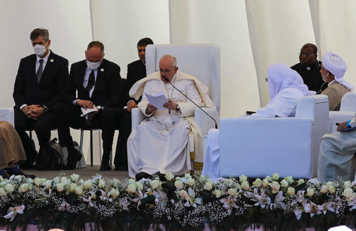 Pope Francis, center, speaks during an interreligious meeting near the archaeological site of Ur near Nasiriyah, Iraq, Saturday, March 6, 2021. Pope Francis and Iraq's top Shiite cleric delivered a powerful message of peaceful coexistence Saturday, urging Muslims in the war-weary Arab nation to embrace Iraq's long-beleaguered Christian minority during an historic meeting in the holy city of Najaf. (AP Photo/Nabil al-Jourani)