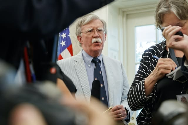 Former US security adviser John Bolton told colleagues he briefed Trump on the intelligence assessment in March 2019 (AP)