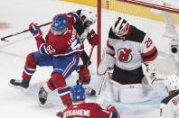 Montreal Canadiens' Artturi Lehkonen (62) moves in on New Jersey Devils goaltender Mackenzie Blackwood as Devils' P.K. Suban defends (76) during the second period of an NHL hockey game in Montreal, Saturday, Nov. 16, 2019. (Graham Hughes/The Canadian Press via AP)
