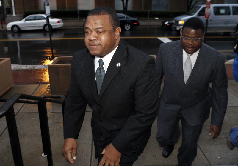 Trenton New Jersey Mayor Tony Mack (L) and his brother Ralphiel Mack arrive at United States Court in Trenton, New Jersey in this January 6, 2014 file photo. Tony Mack was found guilty February 7, 2014 of federal extortion and bribery charges after being ensnared in a 2010 sting operation involving the development of a parking garage on city-owned property in New Jersey's capital city. REUTERS/Mike Segar/Files (UNITED STATES - Tags: CRIME LAW POLITICS