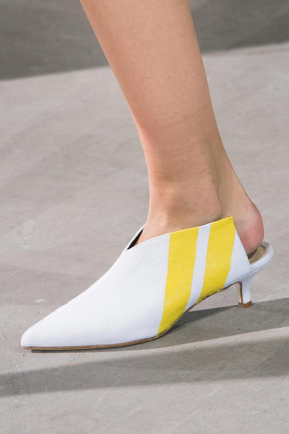 <p><i>Yellow-striped white mules from the SS18 Tibi collection. (Photo: ImaxTree) </i></p>