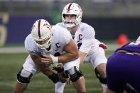 Stanford center Drew Dalman, left, snaps the ball to quarterback Davis Mills in the second half of an NCAA college football game against Washington, Saturday, Dec. 5, 2020, in Seattle. (AP Photo/Elaine Thompson)