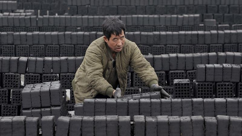 China U-turns on coal ban amid growing outcry over numbers left freezing in winter cold