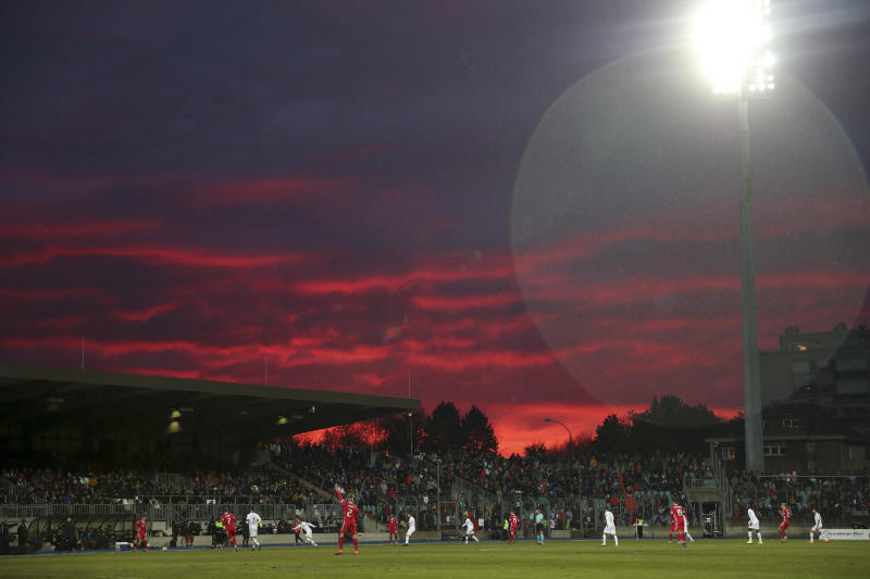 The sun sets over the pitch during the Euro 2020 group B qualifying soccer match between Luxembourg and Portugal at the Josy Barthel stadium in Luxembourg, Sunday, Nov. 17, 2019. (AP Photo/Francisco Seco)