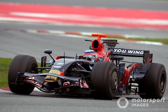 "Toro Rosso STR3 y Red Bull RB4 <span class=""copyright"">Sutton Motorsport Images</span>"