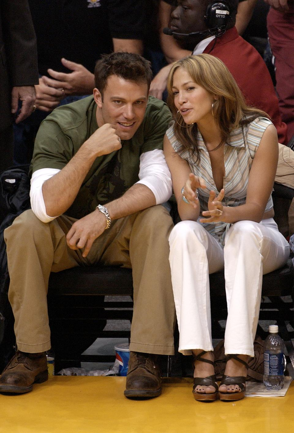 Ben Affleck and Jennifer Lopez attend the Los Angeles Lakers v. San Antonio Spurs playoff game at the Staples Center May 11, 2003 in Los Angeles, California. (Getty Images)