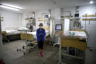 """Chief of Surgical Services Alicia Rey stands inside the ICU of the San Andres Clinic which has been occupied by its former workers since it closed at the start of the year following the death of the hospital's director and owner in Caseros, Argentina, Friday, April 30, 2021. """"It's a shame they don't give us the chance to open the doors and be able to help in this pandemic,"""" said Rey, a representative of the clinic's workers. (AP Photo/Natacha Pisarenko)"""