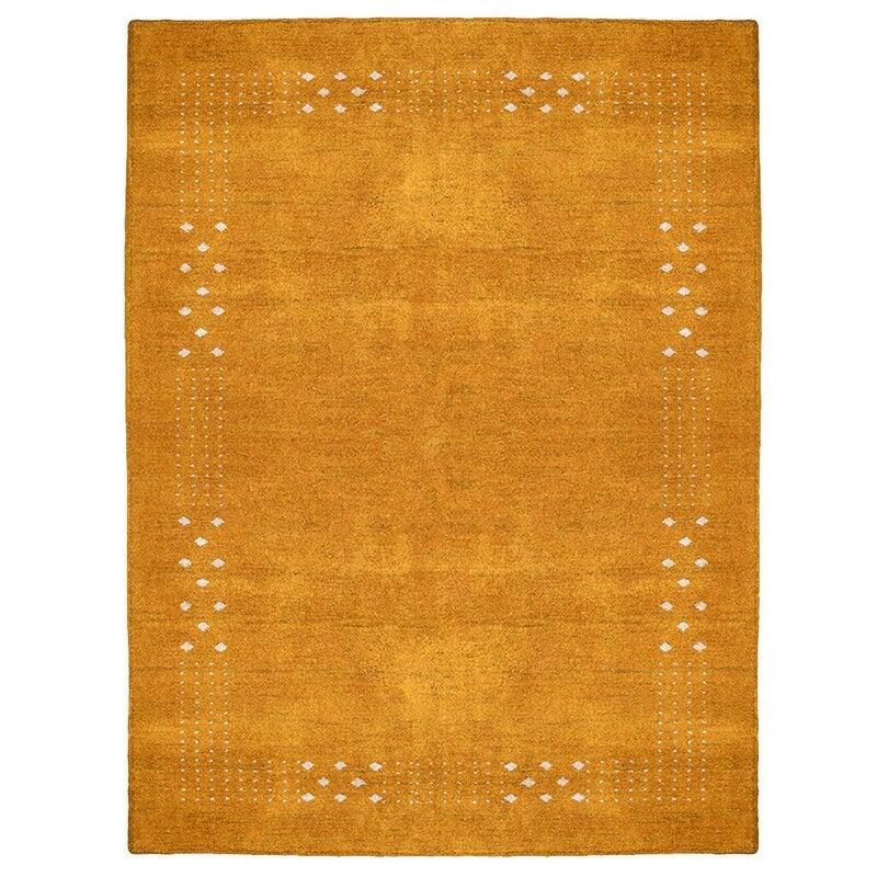 "<br><br><strong>Isabelline</strong> Jarade Hand-Knotted 8' x 10' Rug, $, available at <a href=""https://go.skimresources.com/?id=30283X879131&url=https%3A%2F%2Fwww.wayfair.com%2Frugs%2Fpdp%2Fisabelline-one-of-a-kind-jarade-hand-knotted-8-x-10-area-rug-in-gold-w004844095.html"" rel=""nofollow noopener"" target=""_blank"" data-ylk=""slk:Wayfair"" class=""link rapid-noclick-resp"">Wayfair</a>"