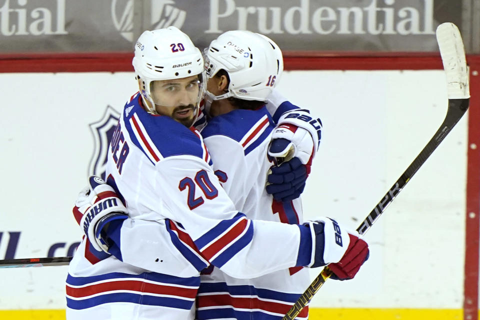 New York Rangers left wing Chris Kreider (20) embraces New York Rangers center Ryan Strome (16) after scoring a goal during the first period of an NHL hockey game against the New Jersey Devils, Thursday, March 4, 2021, in Newark, N.J. (AP Photo/Kathy Willens)