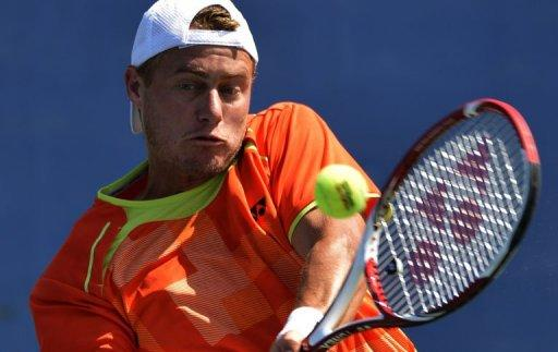 Lleyton Hewitt of Australia returns to Gilles Muller of Luxembourg