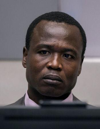 Dominic Ongwen, a former senior rebel commander from the Lord's Resistance Army in Uganda, sits in the courtroom of the International Criminal Court (ICC) during the confirmation of charges in The Hague, the Netherlands January 21, 2016. REUTERS/Michael Kooren/File Photo