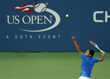Federer of Switzerland serves to Robredo of Spain at the U.S. Open tennis championships in New York