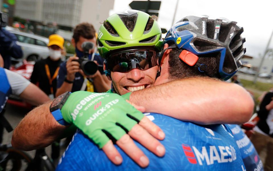Mark Cavendish celebrates with his team-mate Dries Devenyn. - REUTERS