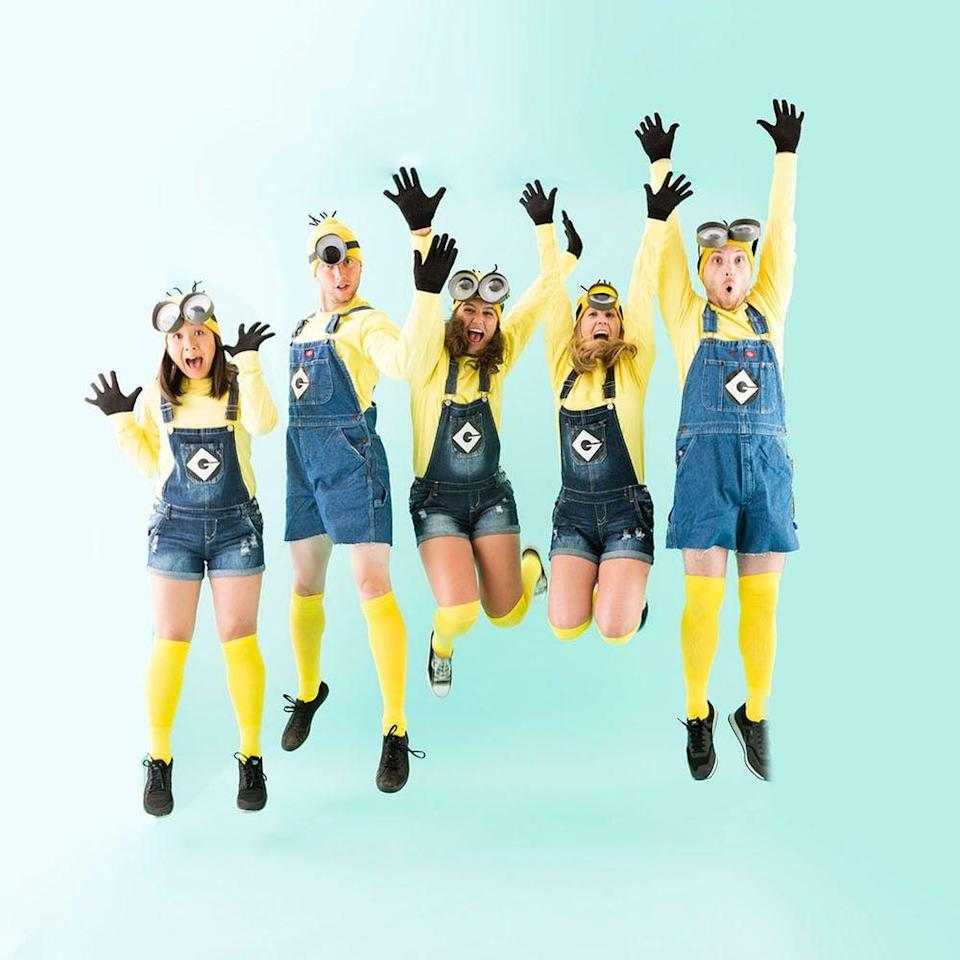 """<p>Are Octobers steamy in your neck of the woods? You can DIY your Minion ensemble with shortalls instead of long overalls. </p><p><strong>Get the tutorial from <a href=""""https://www.brit.co/minion-halloween-group-costume/"""" rel=""""nofollow noopener"""" target=""""_blank"""" data-ylk=""""slk:Brit + Co"""" class=""""link rapid-noclick-resp"""">Brit + Co</a>. </strong></p><p><strong><a class=""""link rapid-noclick-resp"""" href=""""https://www.amazon.com/Boldsocks-Solid-Color-Golden-Yellow/dp/B00GYN3VGC/ref=sr_1_2_sspa?tag=syn-yahoo-20&ascsubtag=%5Bartid%7C10050.g.28305850%5Bsrc%7Cyahoo-us"""" rel=""""nofollow noopener"""" target=""""_blank"""" data-ylk=""""slk:SHOP YELLOW SOCKS"""">SHOP YELLOW SOCKS</a><br></strong></p>"""