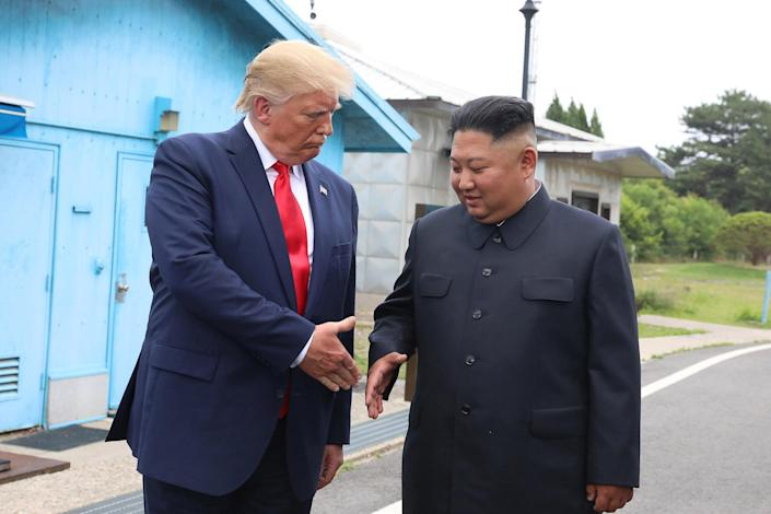 Image: North Korean leader Kim Jong Un and President Donald Trump inside the demilitarized zone (DMZ) separating the South and North Korea on June 30, 2019 in Panmunjom, South Korea. (Dong-A Ilbo / Getty Images file)
