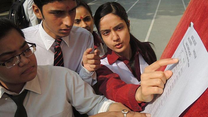 Students check their test scores