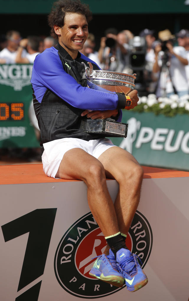 Spain's Rafael Nadal poses with the men's winner cup after the final match of the French Open tennis tournament at the Roland Garros stadium, Sunday, June 11, 2017 in Paris. Nadal has won his record 10th French Open title, beating No. 3 Stan Wawrinka in straight sets (AP Photo/Michel Euler)