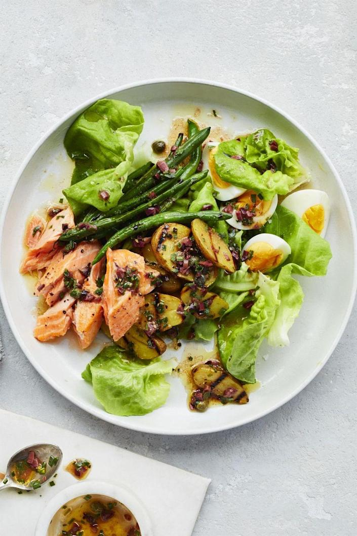"""<p> Change up the usual Niçoise salad by using salmon instead of anchovies or tuna.</p><p><em><a href=""""https://www.womansday.com/food-recipes/food-drinks/recipes/a59397/salmon-nicoise-salad-recipe/"""" rel=""""nofollow noopener"""" target=""""_blank"""" data-ylk=""""slk:Get the Salmon Niçoise Salad recipe."""" class=""""link rapid-noclick-resp"""">Get the Salmon Niçoise Salad recipe.</a></em></p>"""