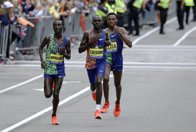 Kenneth Kipkemoi, left, and Lawrence Cherono, center, both of Kenya, and Lelisa Desisa, of Ethiopia, run the course during he 123rd Boston Marathon on Monday, April 15, 2019, in Boston. (AP Photo/Steven Senne)