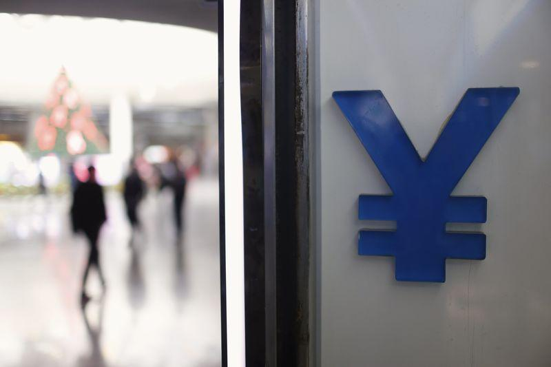 A logo of yuan is seen at a foreign exchange store in Shanghai