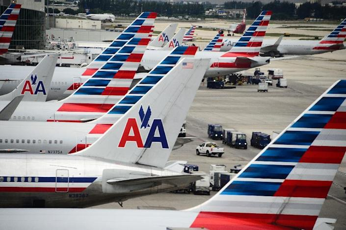 American Airlines has offered a base pay boost of five percent to flight attendants and eight percent to pilots (AFP Photo/ROBYN BECK)