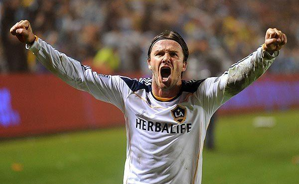 Galaxy midfielder David Beckham celebrates as time expires.This is the Galaxy's third MLS championship and the first since 2005. It's also Beckham's first title in L.A.