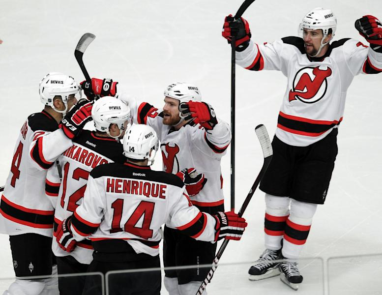 New Jersey Devils' David Clarkson, center right, celebrates with teammates after scoring a goal against the New York Rangers during the third period of Game 2 of an NHL hockey Stanley Cup Eastern Conference final playoff series, Wednesday, May 16, 2012, at New York's Madison Square Garden. (AP Photo/Julio Cortez)