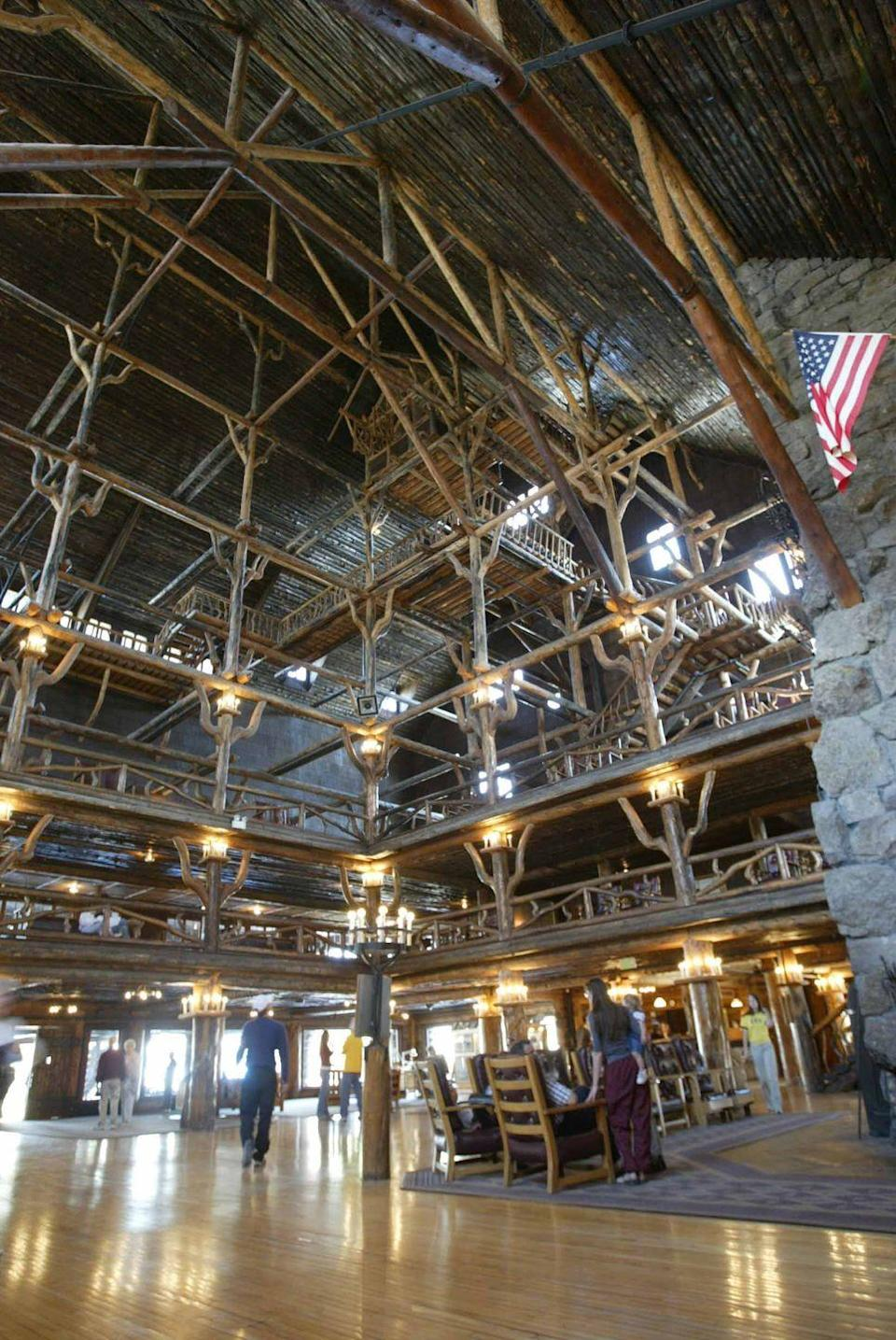 "<p>First opened in the spring of 1904, <a href=""https://www.yellowstonenationalparklodges.com/lodgings/hotel/old-faithful-inn/"" rel=""nofollow noopener"" target=""_blank"" data-ylk=""slk:Old Faithful Inn"" class=""link rapid-noclick-resp"">Old Faithful Inn</a> was the first of the great park lodges built in the American west. It's most iconic design feature, the Old House that contains the seven-story high lobby atrium supported by a log pole interior framework, was restored in 2004 as part of the lodge's centennial celebration. Today, it's one of the few remaining log hotels in the United States and remains the largest log hotel ever built. Old Faithfull Inn was designated a national landmark in 1987 and is a member of Historic Hotels of America.</p>"