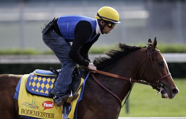 Exercise rider George Alvarez takes Kentucky Derby entrant Bodemeister for a workout at Churchill Downs Friday, May 4, 2012, in Louisville, Ky. (AP Photo/Charlie Riedel)