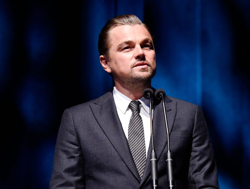 Leonardo DiCaprio looks gorgeous in this fine grey suit with striped tie to match